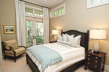The 2nd bedroom has a queen bed. Doors lead to the large deck. En-suite large bathroom.