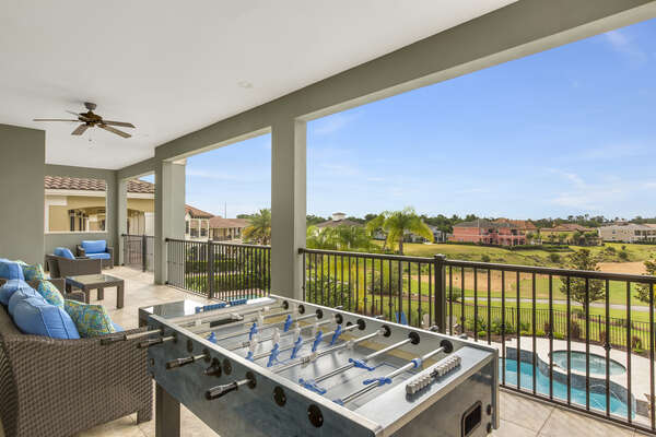 The balcony has an outdoor foosball table and luxury seating