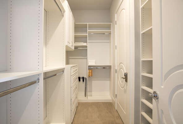 Spacious walk-in closet with built in shelfing