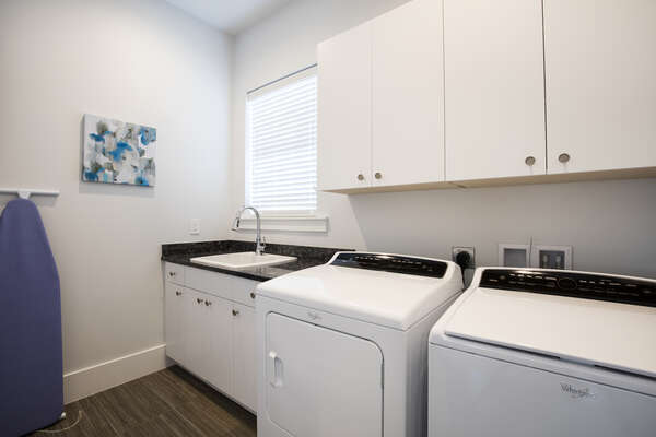 The home is complete with a wash room with full size washer and dryer