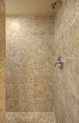 Contemporary snail shower is done in pretty tile
