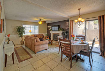 Great room flows into kitchen and has sliding doors to patio