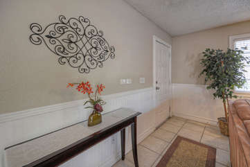 Entrance foyer welcomes you to charming condo