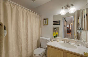 Second bath features a tub/shower combination