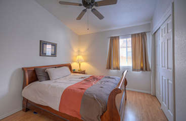 Queen bed and double closet in third bedroom invite you to move in and feel at home
