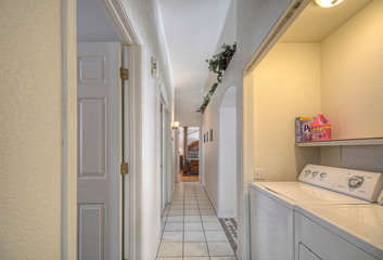 View of hallway and location of laundry facilities