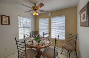 Dining table in bright and spacious area off kitchen is perfect for those at home meals