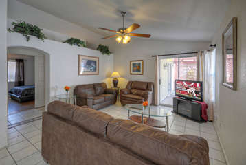 Great room has lots of upgraded plush seating, a newly added Smart TV and sliding doors to the patio