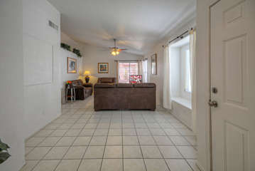 Home is stylish and appealing with vaulted ceilings and pretty tile floors