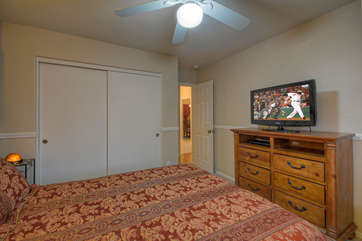 Third bedroom has a queen bed, TV and view of the pool.