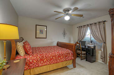 Second bedroom features a queen bed and a desk for  your remote work.