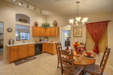 Upgraded kitchen is completely stocked and has table seating for 6.