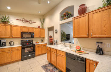 Lots of counter space in bright and cheerful kitchen with pass through to great room.
