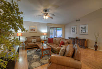 Great room is spacious and comfortable with plenty of seating for everyone.