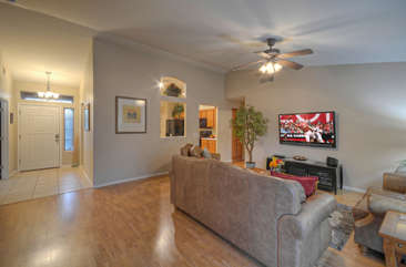 Great room is arranged to view the large smart TV or engage in lively conversations.