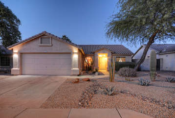 Welcome to our lovely, single story, NE Mesa home with a 2 car garage for your vehicles and golf clubs.