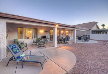 Covered patio with grill is the perfect spot to celebrate your stay in sunny and warm Arizona