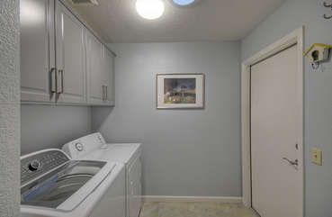 Separate laundry room has family size washer and dryer to keep your wardrobe ready for the next adventure