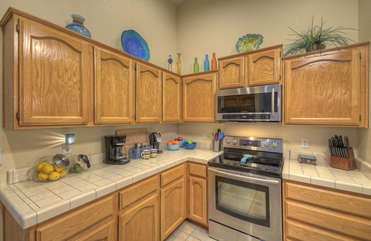 Stylish kitchen features new cabinets, counters (not shown) and stainless steel appliances