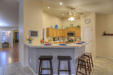 Open bar in kitchen area is perfect for snacks and drinks, meals on the run or take-out from local restaurants