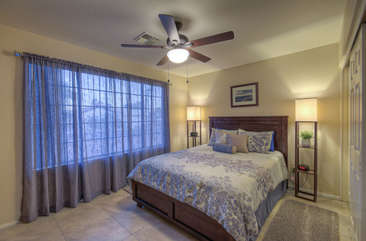 Third bedroom also has a deluxe queen bed, TV and large windows with outdoor view