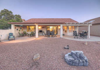 Backyard is spacious and offers a variety of places to relax and dine in sun or shade
