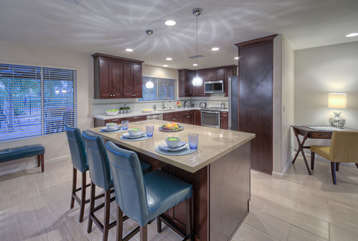 Kitchen is bright and cheerful place to prepare mouthwatering feasts. Corner desk provides space for remote work.