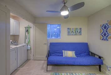 Futon provides an additional sleeping area if needed; laundry facilities are enclosed behind doors