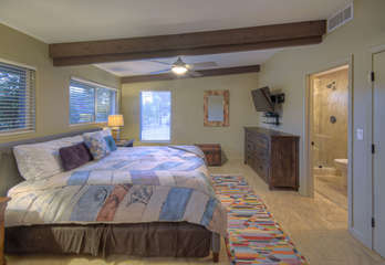 Spacious west primary suite has a TV and walk-in closet