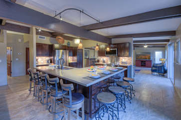 Lots of seating at expansive island in spacious kitchen with exciting outdoor views