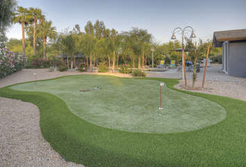 Practice your best shots on your own putting green in our home's backyard.
