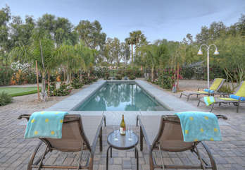SCOTTSDALE SUNDOWN has a pool with comfy lounge chairs and and an amazing view of the Starfire Golf Course.