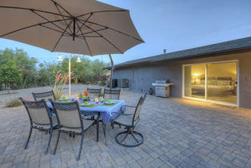Large patio offers exquisite setting for gathering with friends and family.