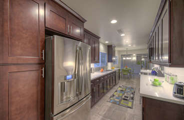 Beautiful designer kitchen is completely stocked so preparing and serving your favorite cuisine is a breeze.