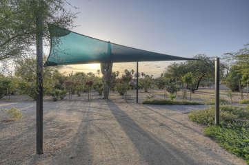 Additional shaded parking is available under the canopy.