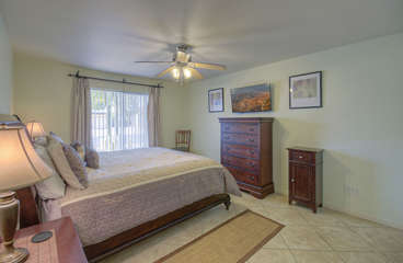Primary bedroom is attractive and has ample drawer and storage space for personal belongings