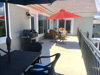 Enjoy the upper deck overlooking the pools with table/chairs, seating area and gas grill for cooking.  Access from the kitchen and living room.