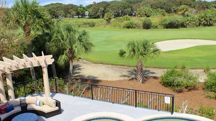 The Beach Club pools, club dining, golf pro shop and Seabrook Shoppe are down the street.