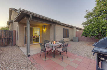 Enjoy outdoor cooking and eating on covered patio with gas grill