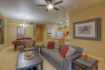 Open floor plan with vaulted ceilings and brand new tile floors creates chic living spaces