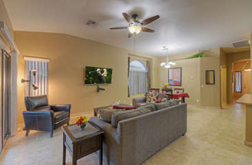 Great room with sleek recliner is ideal for cozy relaxation, lively conversation or cheering your favorite team to victory on TV