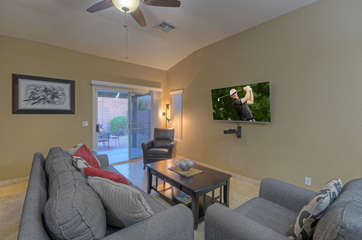 Double doors in great room lead to enclosed yard with covered patio