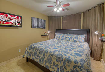Second bedroom is at the front of home and has newly added king bed plus a TV