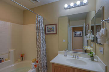 Upstairs master suite includes bath with tub/shower combination