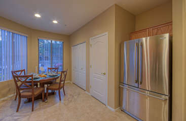 Lovely kitchen has new deluxe fridge, Keurig and a convenient floor plan with laundry area off kitchen and behind double doors