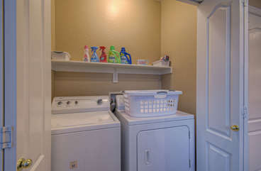 Washer and dryer behind double doors in kitchen area help you keep your wardrobe ready for the next adventure