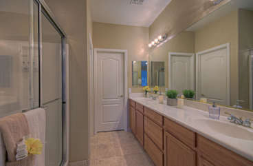 Attractive and efficiently designed master bath has walk-in shower