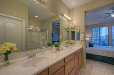 Ground floor master bath has dual vanity sinks so two can primp for night on town