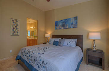 Ground floor master suite has deluxe king bed and views of patio and golf course