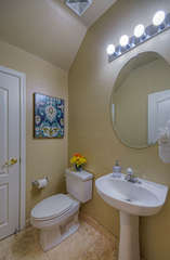 First floor powder room is yet another convenience to enhance guests' comfort